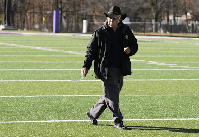Retiring University at Albany head football coach Bob Ford walks across the field that bears his name on Wednesday, Nov. 20, 2013, in Albany, N.Y. The 76-year-old Ford ranks first among active FCS coaches with 265 career victories and fourth all-time. And the school believes he's the only coach to take a team from the club level to Div. III, Div. II, and Div. I at one institution. (AP Photo/Mike Groll)