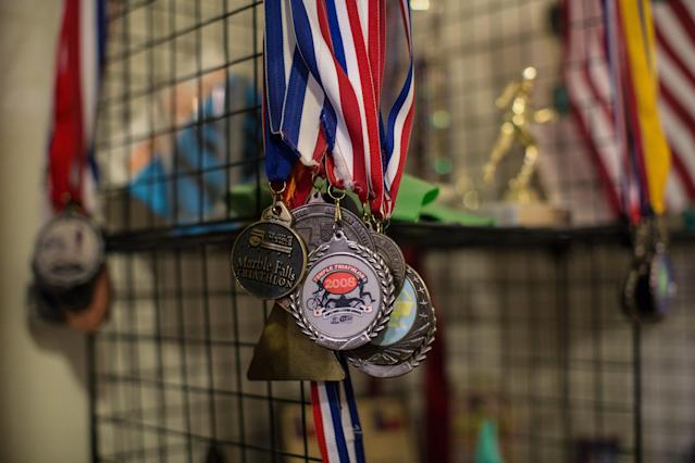 Trophies, plaques, ribbons, medals and other mementos from Yarling's triathlon racing career are displayed at his home. (Tamir Kalifa for HuffPost)