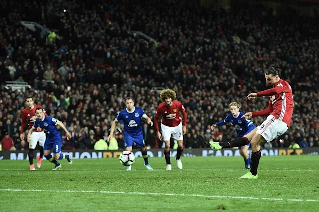Manchester United's striker Zlatan Ibrahimovic shoots from the penalty spot to scores his team's first goal during the English Premier League football match against Everton at Old Trafford in Manchester, England, on April 4, 2017 (AFP Photo/Oli SCARFF )