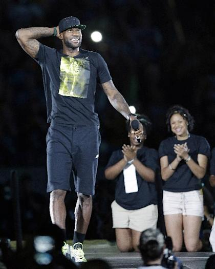 Cleveland Cavaliers' LeBron James addresses the audience at InfoCision Stadium at his homecoming Friday, Aug. 8, 2014, in Akron, Ohio. (AP Photo/Tony Dejak)