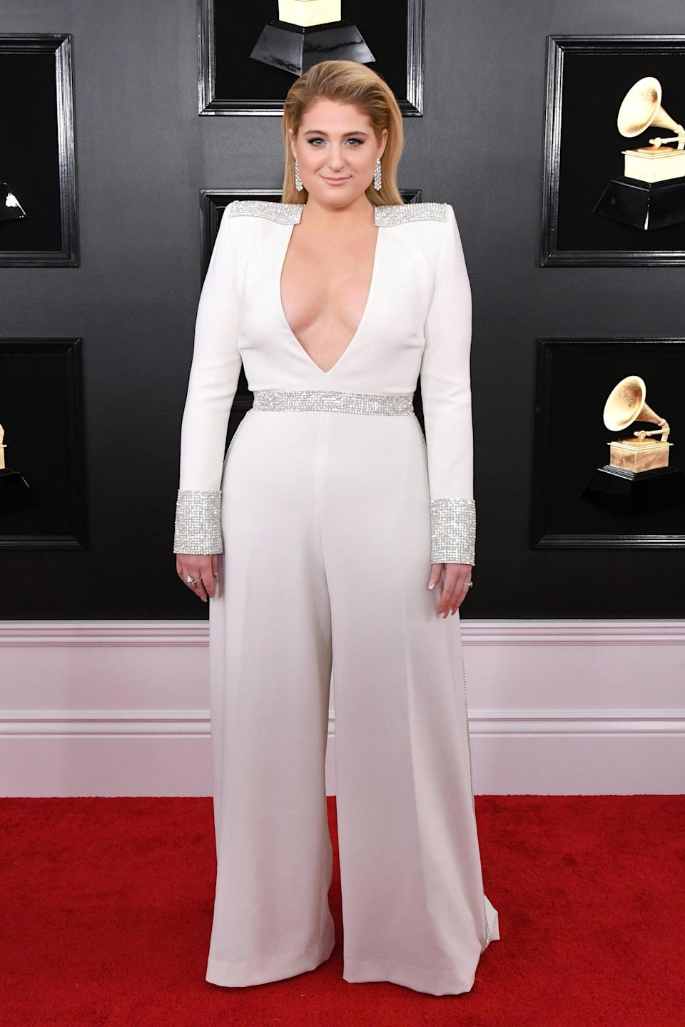<p>Wearing a Christian Siriano jumpsuit with Forevermark jewels and Sam Edelman shoes.</p>