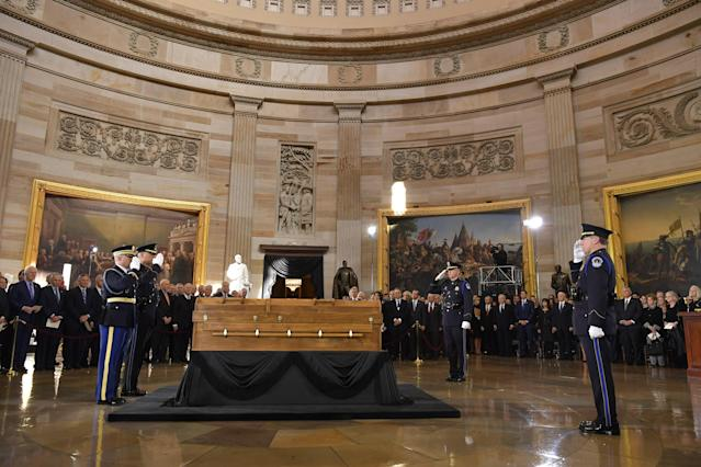 <p>The casket of evangelist Billy Graham arrives at the US Capitol Rotunda on Feb. 28, 2018 in Washington. (Photo: Mandel NganAFP/Getty Images) </p>