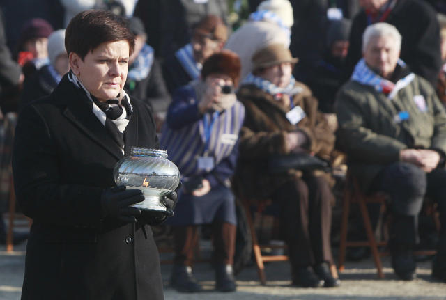 <p>Polish Prime Minister Beata Szydlo lights a candle at the International Monument to the Victims of Fascism, after a ceremony marking the 72nd anniversary of the liberation of the German Nazi death camp Auschwitz-Birkenau, in Oswiecim, Poland, Friday, Jan. 27, 2017, on the International Holocaust Remembrance Day. (Photo: Czarek Sokolowski/AP) </p>