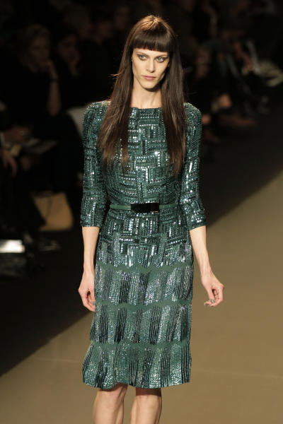 A model presents a creation by Lebanese designer Elie Saab as part of his Women's Fall-Winter, ready-to-wear 2013 fashion collection, during the Paris Fashion week, Wednesday, March 7, 2012. (AP Photo/Michel Euler)