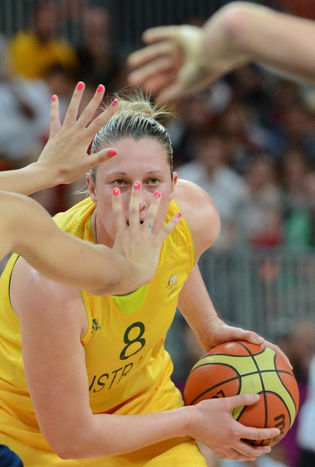 TOPSHOTS Australian center Suzy Batkovic dribbles during the women's preliminary round group B basketball match of the London 2012 Olympic Games Australia vs Great Britain on July 28, 2012 at the basketball arena in London. AFP PHOTO / TIMOTHY A. CLARYTIMOTHY A. CLARY/AFP/GettyImages