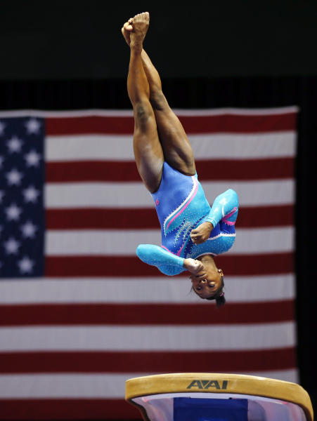 Simone Biles competes on the vault during the U.S. women's national gymnastics championships in Hartford, Conn. Thursday, Aug. 15, 2013. (AP Photo/Elise Amendola)
