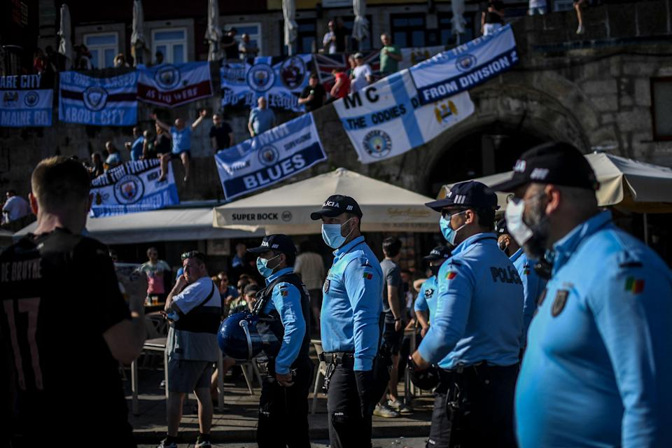 Local police keep an eye on English fans (AFP via Getty Images)