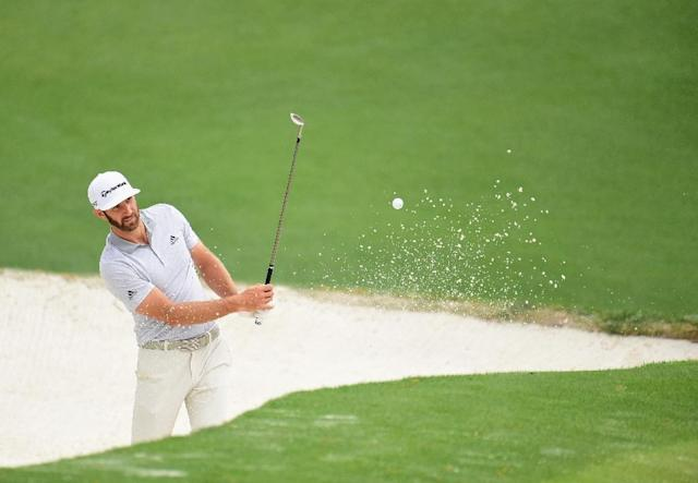 32-year-old world number one Dustin Johnson missed the Masters because of a back injury (AFP Photo/Harry How)