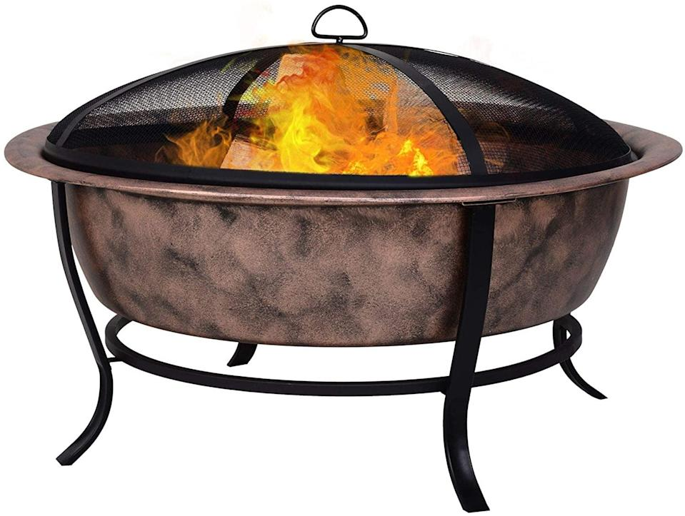 """<p>The <span>Outsunny 35"""" Outdoor Fire Pit </span> ($120) is a wood-burning, rustic, cauldron-style, steel firepit that comes with a log poker and a mesh screen enclosure.</p>"""