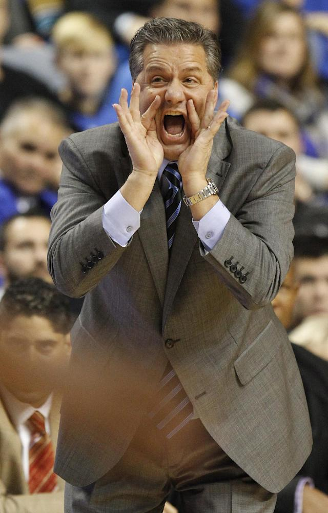 Kentucky head coach John Calipari shouts to his team during the first half of an NCAA college basketball game against Eastern Michigan, Wednesday, Nov. 27, 2013, in Lexington, Ky. (AP Photo/James Crisp)
