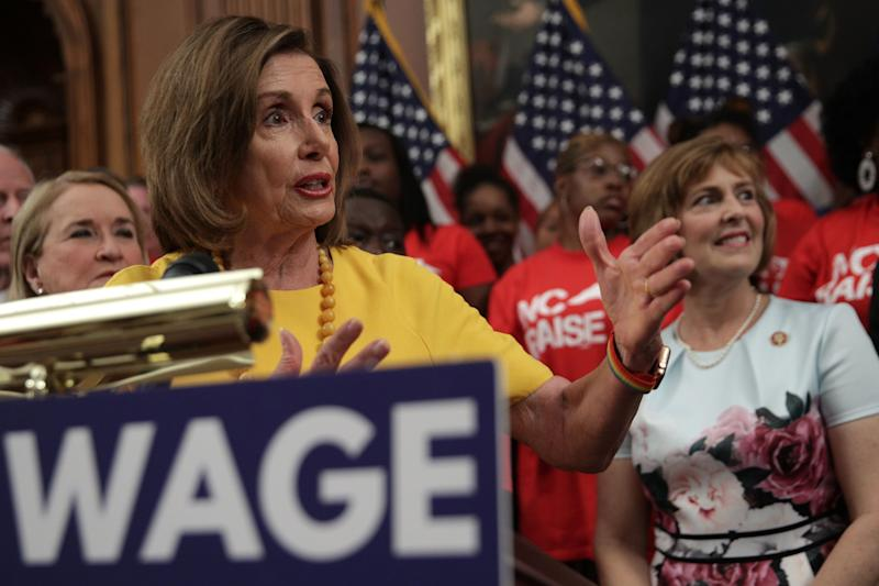 """House Speaker Nancy Pelosi said the bill to increase the federal minimum wage would provide a """"well-earned raise."""" (Photo: Alex Wong via Getty Images)"""