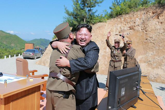<p>North Korean leader Kim Jong Un reacts with scientists and technicians of the DPRK Academy of Defence Science after the test launch of the intercontinental ballistic missile Hwasong-14 in this undated photo released by North Korea's Korean Central News Agency (KCNA) in Pyongyang July, 5, 2017. (Photo: KCNA/via Reuters) </p>