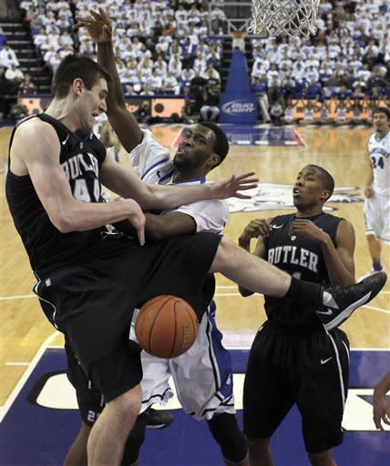 Butler's Andrew Smith, left, cannot come up with a rebound as Saint Louis' Cory Remekun, center, defends and Butler's Kameron Woods watches during the first half of an NCAA college basketball game Thursday, Jan. 31, 2013, in St. Louis. (AP Photo/Jeff Roberson)