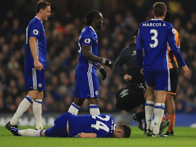 <p>Cahill is hurt as part of the collision </p>