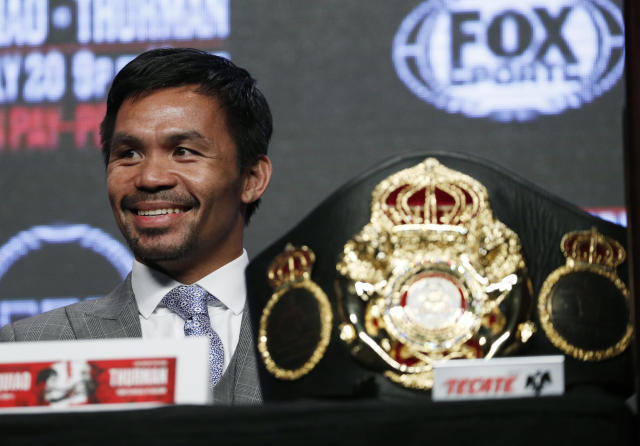 Manny Pacquiao smiles during a news conference Wednesday, July 17, 2019, in Las Vegas. Pacquiao is scheduled to fight Keith Thurman in a welterweight championship boxing match Saturday in Las Vegas. (AP Photo/John Locher)