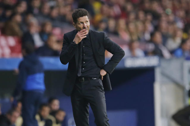 FILE - In this Tuesday, Oct. 31, 2017 file photo, Atletico coach Diego Simeone watches the game during a Group C Champions League soccer match between Atletico Madrid and Qarabag at the Metropolitano stadium in Madrid, Spain. Nearly 20 years after his father scuppered Juventus' title hopes, Giovanni Simeone has made it up to the Serie A club. Current Atletico Madrid coach Diego Simeone fired Lazio to a 1-0 win against Juventus in April 2000, with the capital club going on to finish a point above the Bianconeri to win the title. On Sunday, 18 years later, the younger Simeone netted a hat trick to help Fiorentina beat Juve's closest challengers Napoli 3-0 and leave the Bianconeri on the brink of a seventh successive title. (AP Photo/Paul White, File)