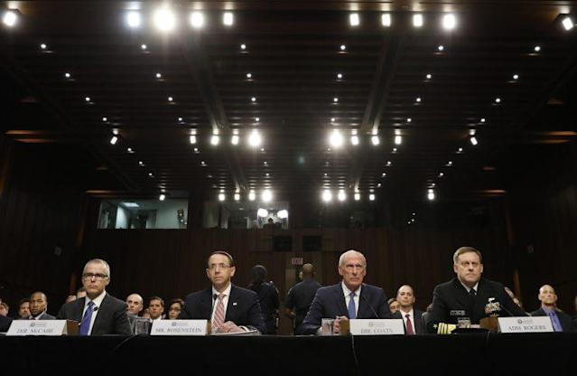 Director of National Intelligence Daniel Coats (2NDR) ; Acting FBI Director Andrew McCabe (L) ; National Security Agency Director Michael Rogers (R); and Deputy Attorney General Rod Rosenstein (2NDL) are seated to testify before a Senate Intelligence Committee hearing on the Foreign Intelligence Surveillance Act (FISA) in Washington, D.C., June 7, 2017. (Photo: Kevin Lamarque/Reuters)