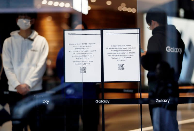FILE PHOTO: Closed notices are displayed at the entrance of Galaxy Harajuku store in Tokyo