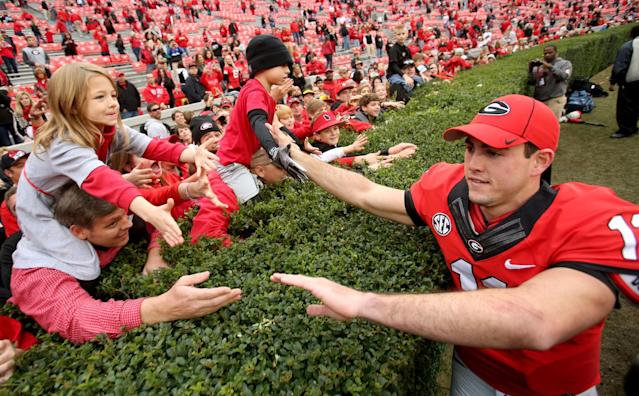 Georgia quarterback Aaron Murray celebrates with fans after their 45-6 win over Appalachian State in an NCAA college football game at Sanford Stadium in Athens, Ga., Saturday, Nov. 9, 2013. (AP Photo/Atlanta Journal-Constitution, Jason Getz)
