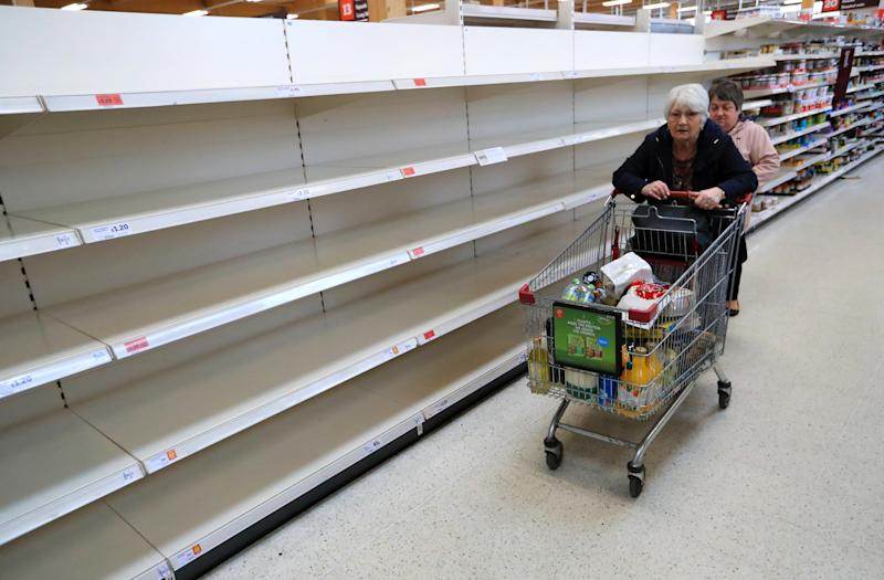 Shop shelves are left empty at Sainsburys in Leicester after NHS England announced that the coronavirus death toll had reached 104 in the UK.