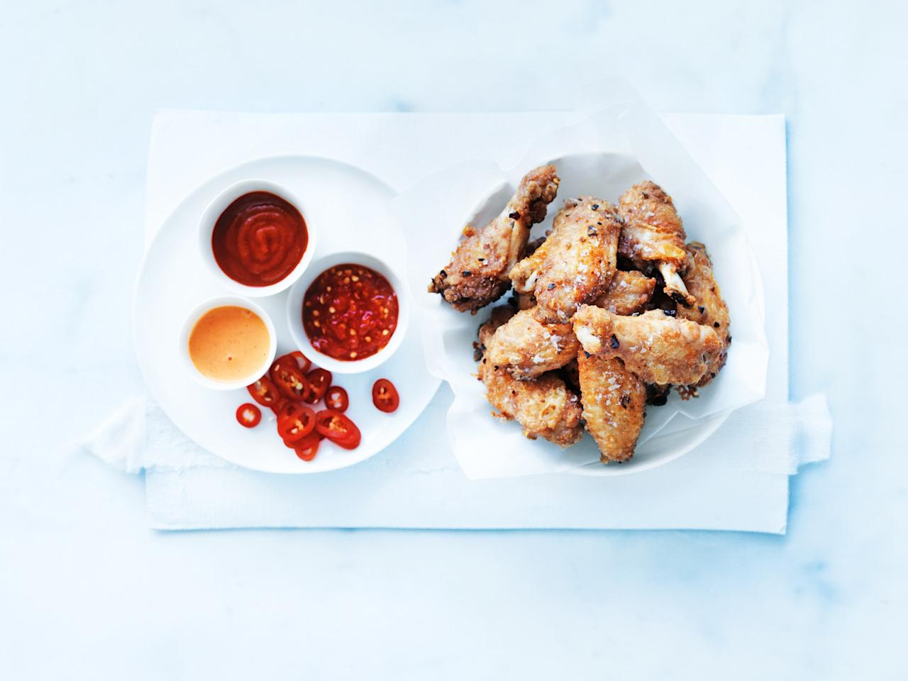 "Use cornstarch to get the snappy exterior on these crispy chicken wings. Serve with chili sauce, chilies, and chili mayonnaise and you'll score a taste touchdown. <a href=""https://www.epicurious.com/recipes/food/views/crispy-chicken-wings-56390078?mbid=synd_yahoo_rss"">See recipe.</a>"