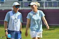 Leader Madelene Sagstrom has a laugh with her caddie during the opening round at Kasumigaseki Country Club