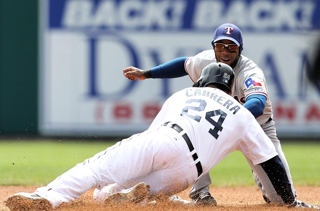 DETROIT, MI - APRIL 22: Miguel Cabrera #24 of the Detroit Tigers is tagged out at second base after stretching a single in the third inning by Elvis Andrus #1 of the Texas Rangers during the game at Comerica Park on April 22, 2012 in Detroit, Michigan. (Photo by Leon Halip/Getty Images)