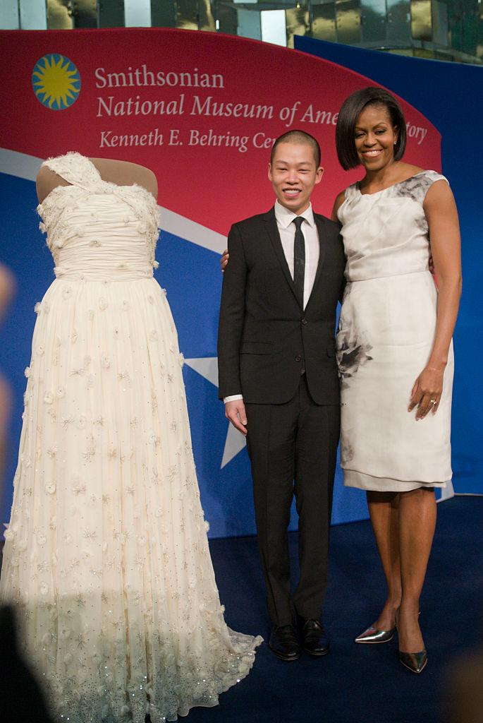 In 2010, FLOTUS stands with Wu as the dress he designed for her first Inaugural Ball is inducted into the Smithsonian Institute. (Photo: Getty)