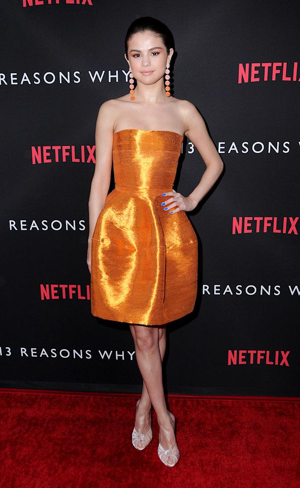 <p>Orange is the new black? Gomez dared to be different when she sported this bright metallic Oscar de la Renta cocktail frock and contrasting blue nails to the L.A. premiere of Netflix's <em>13 Reasons Why.</em> While we're not sure if we're feeling the shoes, her overall look is on point.<br />(Photo: AdMedia/Splash News) </p>
