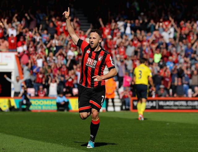 Marc Pugh wheels away in celebration after scoring Bournemouth's third goal