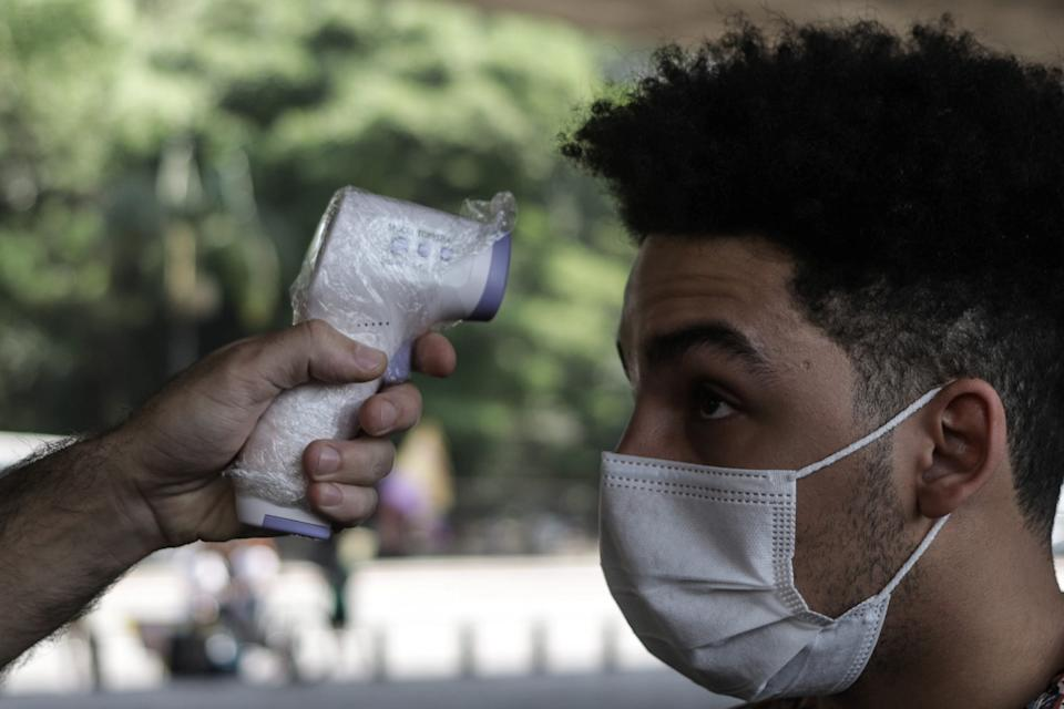 SAO PAULO, Oct. 13, 2020 -- A visitor gets his temperature checked at Sao Paulo Museum of Art after its reopening amid COVID-19 outbreak in Sao Paulo, Brazil, on Oct. 13, 2020. (Photo by Rahel Patrasso/Xinhua via Getty) (Xinhua/Rahel Patrasso via Getty Images)