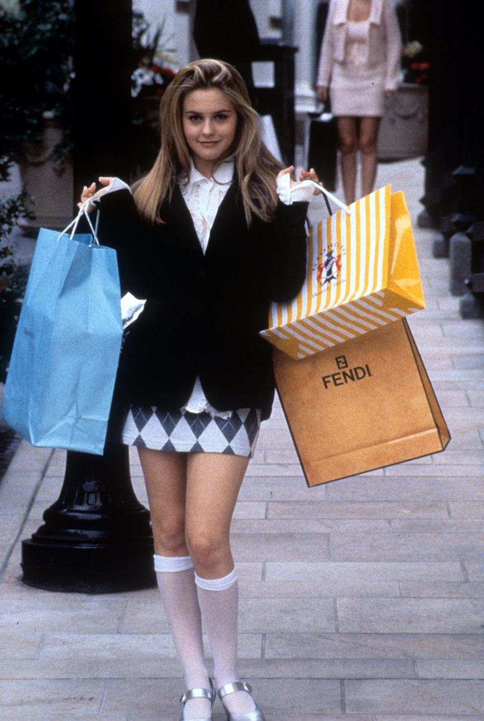 """<p><a href=""""https://www.popsugar.com/fashion/alicia-silverstone-talks-about-clueless-looks-video-47733872"""" class=""""link rapid-noclick-resp"""" rel=""""nofollow noopener"""" target=""""_blank"""" data-ylk=""""slk:The Clueless star's"""">The <strong>Clueless</strong> star's</a> black blazer jacket, plaid skirt, and high white socks still has us totally buggin' decades later. </p>"""