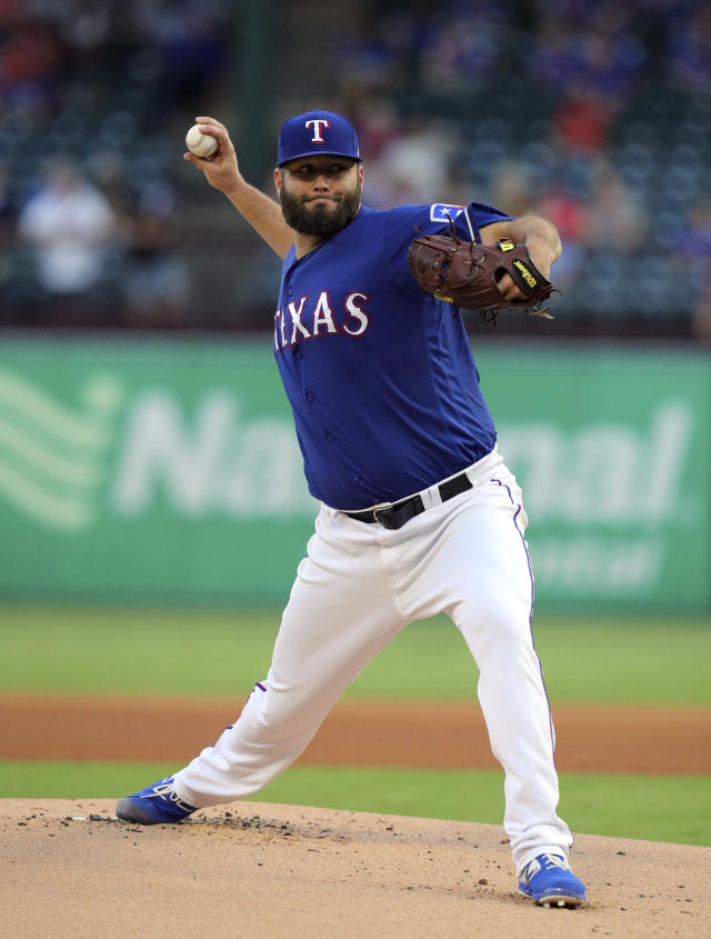 Texas Rangers starter Lance Lynn (35) delivers a pitch during the first inning of a baseball game against the Tampa Bay Rays Tuesday, Sept. 10, 2019, in Arlington, Texas. (AP Photo/Richard W. Rodriguez)
