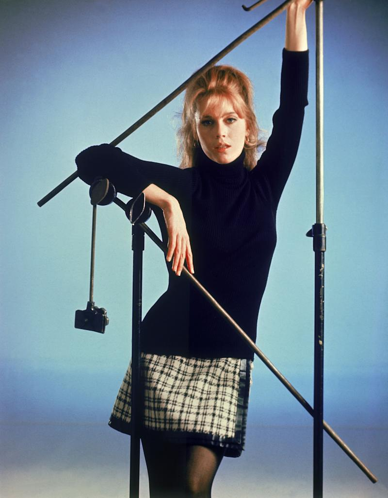 A black turtleneck and camera equipment frame her rising-star face.