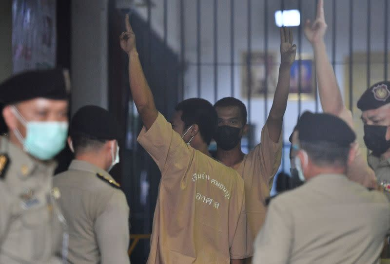 FILE PHOTO: Arrested anti-government protesters arrive at criminal court to face lese majeste charges in Bangkok