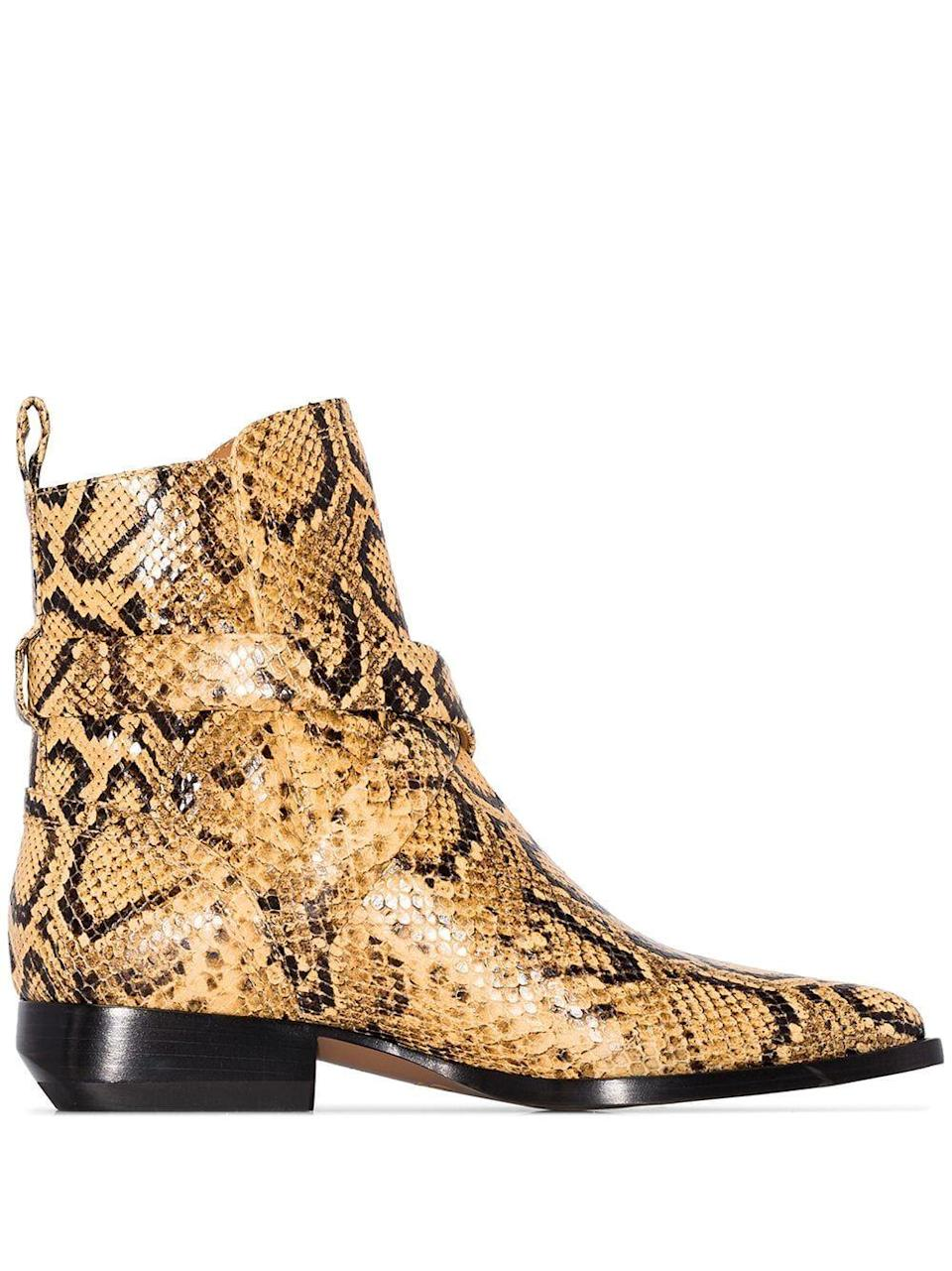 """<p><strong>Chloé</strong></p><p>farfetch.com</p><p><strong>$504.00</strong></p><p><a href=""""https://go.redirectingat.com?id=74968X1596630&url=https%3A%2F%2Fwww.farfetch.com%2Fshopping%2Fwomen%2Fchloe-rylee-30mm-snake-effect-ankle-boots-item-13998059.aspx&sref=https%3A%2F%2Fwww.harpersbazaar.com%2Ffashion%2Ftrends%2Fg7958%2Fhow-to-wear-ankle-boots%2F"""" rel=""""nofollow noopener"""" target=""""_blank"""" data-ylk=""""slk:Shop Now"""" class=""""link rapid-noclick-resp"""">Shop Now</a></p><p>High shine, rich texture, and the ideal walking heel: This luxe boot not only looks cool with a miniskirt, but just about everything else in your wardrobe too. </p>"""