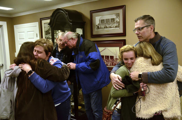 <p>Patrick Adamson, youth director and praise leader at Briensburg Baptist Church, comforts two people prior to a prayer vigil at Briensburg Baptist Church near Benton, Ky., Jan. 23, 2018. Bailey Nicole Holt and Preston Ryan Cope, both 15, were killed and more than a dozen injured when a classmate opened fire Tuesday morning in the Marshall County High School atrium, a common area at the school where several hallways meet and students gather before classes. (Photo: Stephen Lance Dennee/AP) </p>