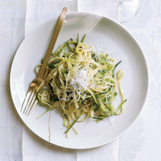 """<p>Grace Parisi treats shredded zucchini and scallions just like the linguine in this lush dish: She tosses them all in a buttery sauce with lemon thyme and tarragon and finishes the dish with pecorino cheese.</p><p><a href=""""https://www.foodandwine.com/recipes/zucchini-linguine-with-herbs"""">GO TO RECIPE</a></p>"""