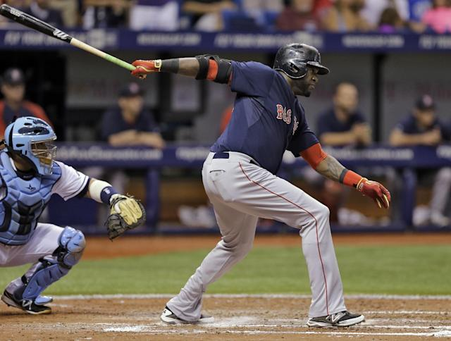 Boston Red Sox's David Ortiz, right, hits an RBI-single off Tampa Bay Rays starting pitcher David Price during the sixth inning of a baseball game on Friday, July 25, 2014, in St. Petersburg, Fla. Red Sox's Dustin Pedroia scored on the hit. Rays catcher Jose Molina, left, looks on. (AP Photo/Chris O'Meara)