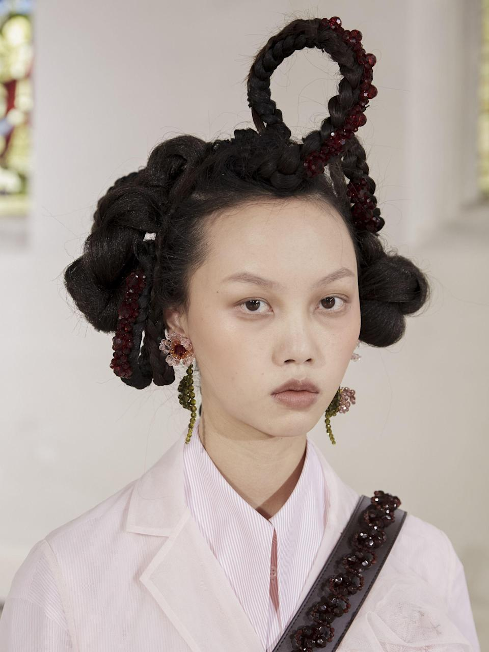 """<p>Whether it's elaborate embellished updos, an 80s perm revival or the fash crowd's go-to 'I woke up like this' hair, fashion month is the place to get all your hair inspiration for next season.</p><p>From Chanel and Fendi, to Simone Rocha and Molly Goddard, check out the best backstage <a href=""""https://www.elle.com/uk/beauty/hair/g32408/hairstyle-trends/"""" rel=""""nofollow noopener"""" target=""""_blank"""" data-ylk=""""slk:hairstyles and trends"""" class=""""link rapid-noclick-resp"""">hairstyles and trends</a> from fashion week AW21, right here.</p>"""