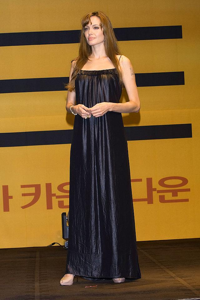 "After dropping jaws around the world in awesome outfits while promoting her new spy flick, ""Salt,"" Angelina Jolie was bound to falter, which she did at a South Korean press conference in this crinkled catastrophe and mismatched heels. Han Myung-Gu/<a href=""http://www.wireimage.com"" target=""new"">WireImage.com</a> - July 28, 2010"