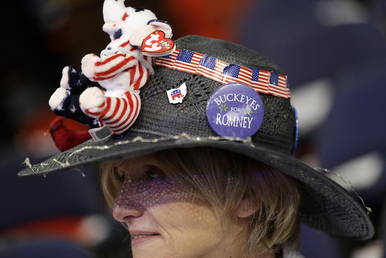 Ohio Delegate Ranae Lentz from Bellefontaine, Ohio fashions her hat on the floor at the Republican National Convention in Tampa, Fla., on Tuesday, Aug. 28, 2012. (AP Photo/Charles Dharapak)