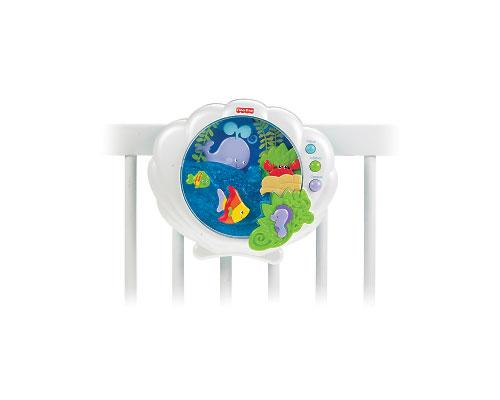 <b>Ocean Wonders Deep Blue Sea Soother by Fisher-Price</b><br><br>The Ocean Wonders Deep Blue Sea Soother is shaped like a clam shell and has a white, pearlized casing. Parents can choose from three different types of music that can play for up to 18 minutes: lullabies, classical and ocean sounds. In the soother, a crab plays peek-a-boo; a whale plays hide-and-seek; and a fish swims on a wave. Suggested price $54.99, recommended age from birth to 24 months.