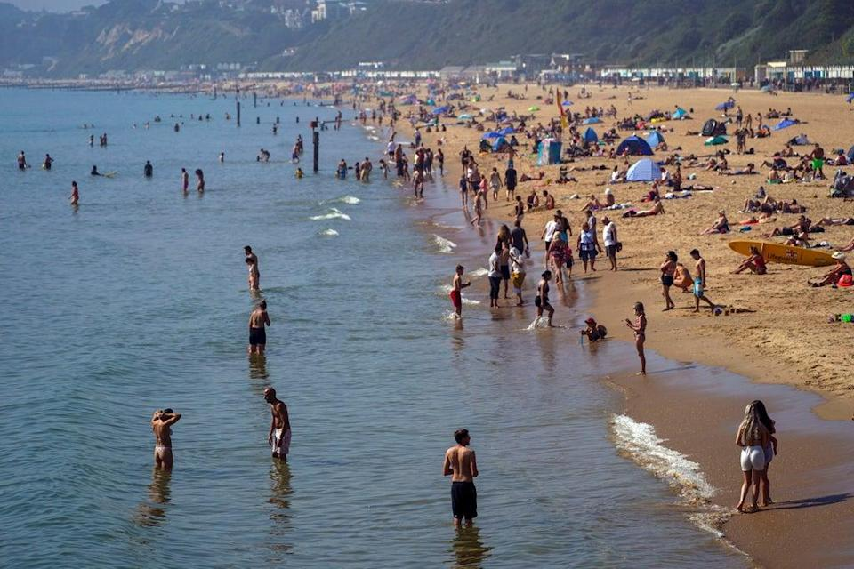 Britain to be hotter than Lisban this weekend (Pictured: Bournemouth Beach in Dorset)  (PA)