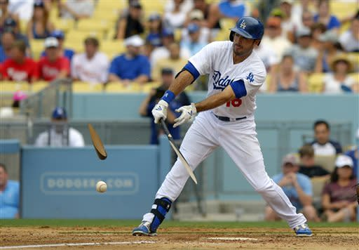 Los Angeles Dodgers' Andre Ethier breaks his bat as he hits during the eighth inning of their baseball game against the Philadelphia Phillies, Sunday, June 30, 2013, in Los Angeles. Ethier was thrown out at first on the play. (AP Photo/Mark J. Terrill)