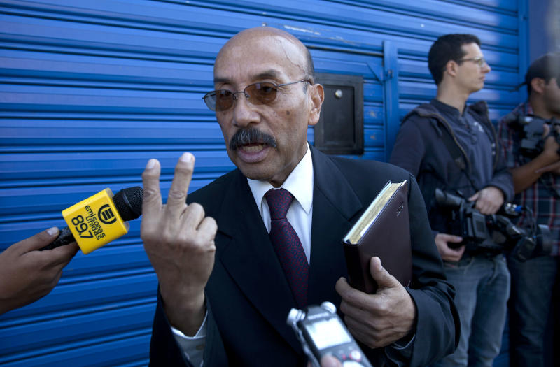 Telesforo Guerra, the lawyer of software company founder John McAfee, speaks to journalist outside the detention immigration center where McAfee is being held, in Guatemala City, Friday, Dec. 7, 2012.  Guerra told reporters that the creator of the McAfee antivirus program is in good health, and his team is filing four separate legal appeals in an effort to prevent his return to Belize. (AP Photo/Moises Castillo)