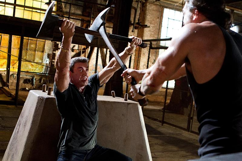 """This film image released by Warner Bros. Pictures shows Sylvester Stallone, left, and Jason Momoa in a scene from """"Bullet to the Head."""" (AP Photo/Warner Bros. Pictures, Frank Masi)"""
