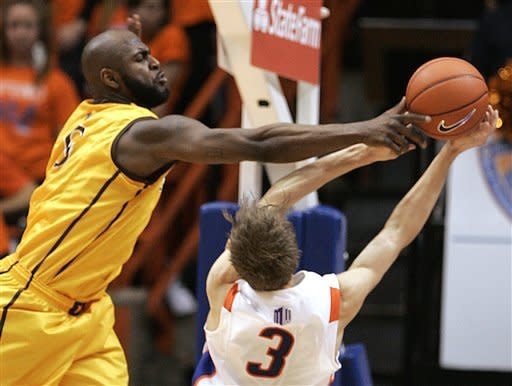Wyoming's Leonard Washington (0) blocks the shot of Boise State's Anthony Drmic (3) during the first half of an NCAA college basketball game, Saturday, Feb. 9, 2013, in Boise, Idaho. (AP Photo/Matt Cilley)
