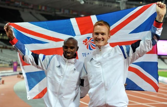 Rutherford pictured with Mo Farah, left, on Super Saturday (Martin Rickett/PA)