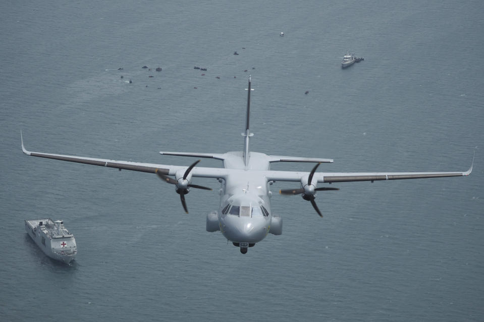 Indonesian Navy's aircraft flies as the search for the wreckage of a crashed Sriwijaya Air passenger jet continues, in this aerial photo taken over the Java Sea, off Jakarta, Indonesia, Tuesday, Jan. 12, 2021. Indonesian navy divers were searching through plane debris and seabed mud Tuesday looking for the black boxes of the Sriwijaya Air jet that nosedived into the Java Sea over the weekend with 62 people aboard. (AP Photo/Eric Ireng)